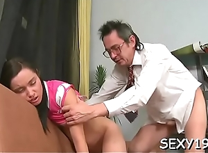 Doll is charming teacher'_s pecker with ambitious blowjob