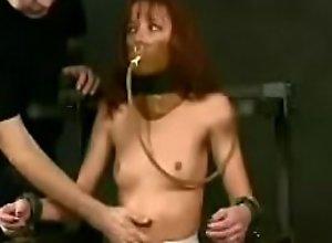 Skinny girl in metal bondage