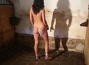 Luna chained nude in the stables