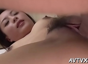 Horny chap is tasting asian babe&#039_s unshaved cunt hungrily