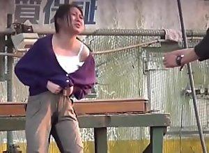 Japanese slut peeing her pants