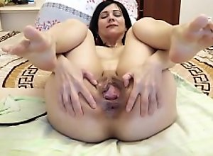 A hot brunette with a big pussy caresses herself..