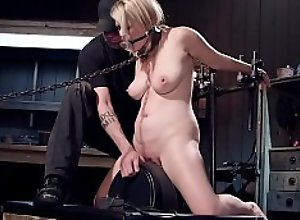 Blonde gets whipped in device bondage