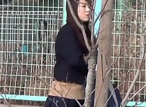 Asian students in uniforms peeing