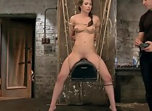 Bound brunette rides Sybian in the air