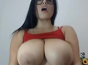 busty beauty lactates on her own face