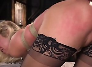 Busty blonde hostage gets anal fucked