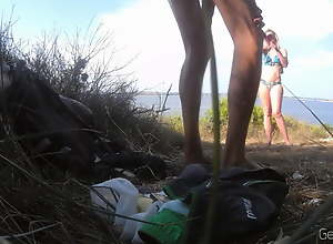 Public beach jerking. The girl passes and talks..