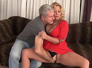Curvy blonde mature with natural boobs gets..