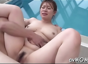 Asian milf gets partial hairless cunt hammered..
