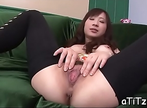 Cute asian with sexy pair stimulates with cross..