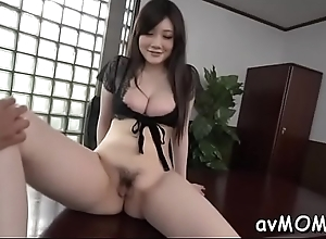 Moaning asian milf near sextoy pampers the brush broad in the beam pussy making levelly wet