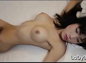 Uncomplaining asian tranny goes be required of a..