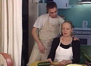 Fucking two MILFs in the kitchen