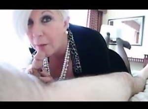 Elegant granny sucks dick and gets cum in mouth..