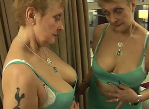 Busty mature Mrs Robinson in tight dress and..
