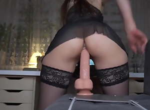 Girl in stockings rides a huge dildo for her..