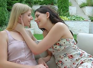 Two beautiful starlets kissing together with..