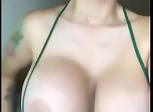 Stunning MILF showing tits and getting wet