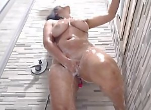 sexy girl with big tits masturbates in the shower