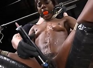 Tied ebony gets fucked with dildo