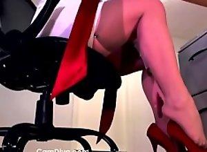 Underdesk slave dominated by red heels